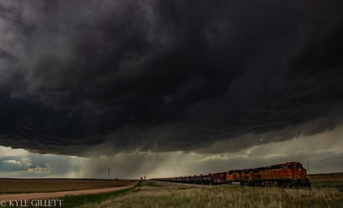 A developing supercell as a train passes beneath it. Yuma County, Colorado. May, 2019. - Kyle Gillett